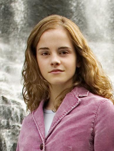 Actress Emma Watson poses