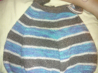 The front of the blue, brown, and silver stripe bubble dress
