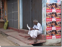 An-elderly-person-eagerly-reads-the-Uthayan-Tamil-newspaper-in-the-morning
