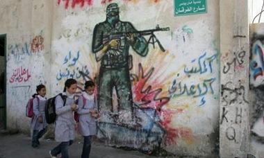 Palestinians-walk-past-pr-008