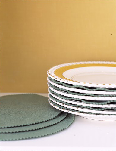 Protect china or everyday tableware from damage with guards cut out of felt or acid-free paper.