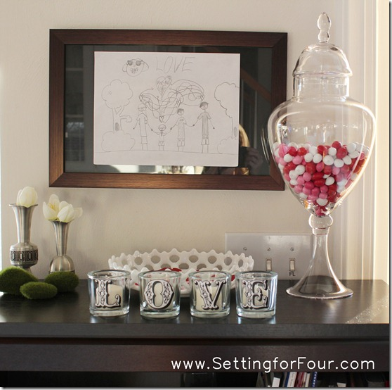 DIY Pottery Barn Inspired Valentine's Candle Votives from Setting for Four.  See the tutorial here: http://settingforfour.blogspot.com/2012/01/love-votive-candle-set.html #diy #modpodge #candle #craft #valentine 