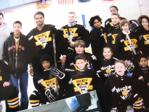Hockey In The Hood team. Squad drives from the city to the Airport area to play hockey throughout the winter / school year. Sadly, a closed rink is in the city.