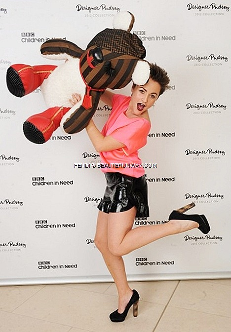 JAIME WINSTONE FENDI Spring Summer 2013 Collection Fall Winter  patent leather pleated hem skirt pink silk top striped black platform heel with tortoise shell heels fendi logo red boots Christie's London Designer Pudsey Bear Auction