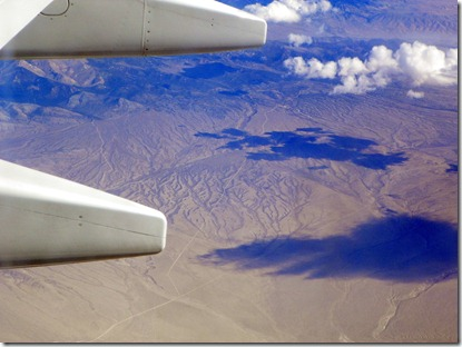 We're in the air!!  The Arizona desert with clouds and cloud shadows.