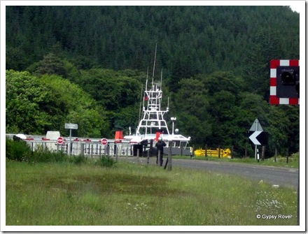 A tug passing through the swing bridge on the Caledonian Canal  at Loch Oich.
