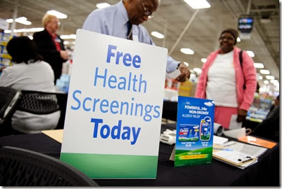 An information booth at a free health screening at Sam's Club