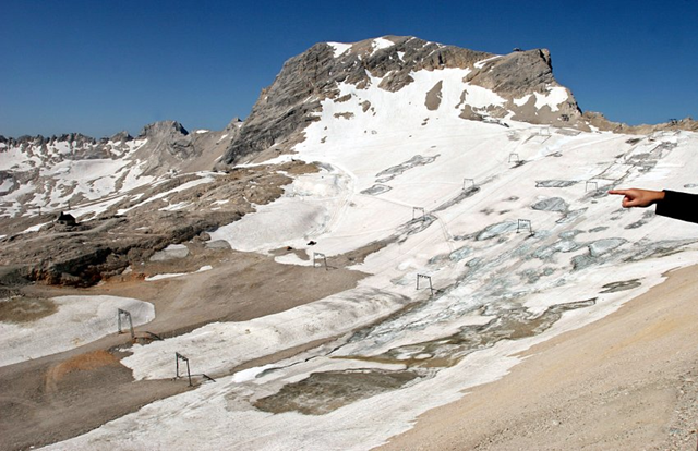 Germany's highest peak, the Zugspitze, will likely lose its Schneeferner glacier, shown here. Temperatures in the Bavarian Alps have increased by some 2 degrees Celsius in the last one-and-a-half centuries -- nearly double the world average, said Bavarian Environment Minister Marcel Huber during a presentation of the state's first-ever glacier report in Munich in early July 2012. Four of the region's five glaciers could melt entirely as a result. DPA
