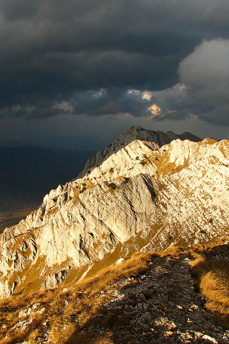 Before the storm. Clouds and sunshine mix over the Piatra Craiului mountains in Romania.