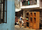 A resident removes the mud from their cabinets. (Photo by RVO/Bulatlat.com)