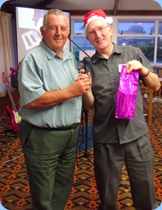 Committee Member, Ken Mahy, presented the Club President, Gordon Sutherland, with a gift to celebrate his 65th Birthday and as an appreciation of the hard work committed to the Club to keep it vibrant. Photo courtesy of Peter Littlejohn.