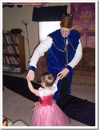 Birthday girl dancing with daddy