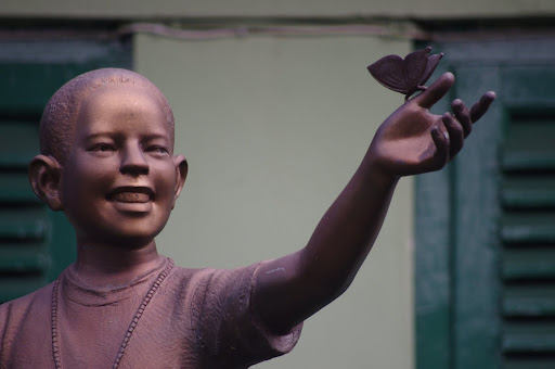 "A statue stands in the school's courtyard, commemorating their famous student, ""Barry."""