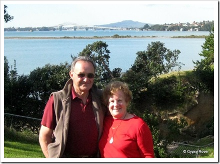 Derek & Dot at Coyle Park with the Auckland Harbour bridge as a back drop. Rangitoto Island beyond the bridge.