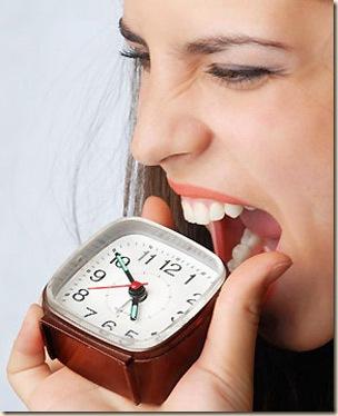 woman-eating-clock-97660689