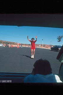 Bruce doing his famous nose wheelie with Chris Carmichael filming him in the back of Brian's station wagon for the movie Spinning Wheels at La Costa. Photo by Lance Smith