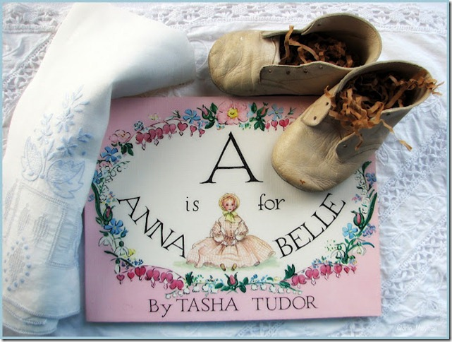 Tasha Tudor book with old baby shoes