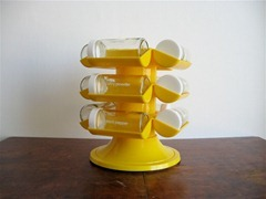Yellow Copco revolving spice rack