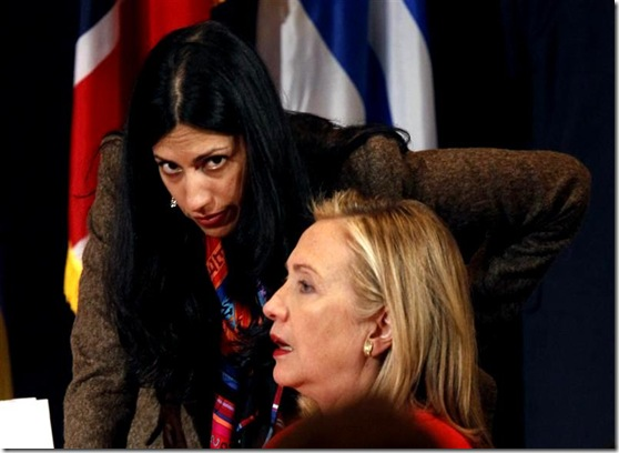 U.S. Secretary of State Hillary Clinton talks with her deputy chief of staff, Huma Abedin, during the Open Government Partnership event in New York September 20, 2011. REUTERS/Kevin Lamarque