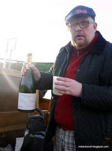 Kenneth uncorks the champagne