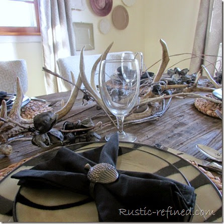 Animal print tablescape with antlers for a woodland theme