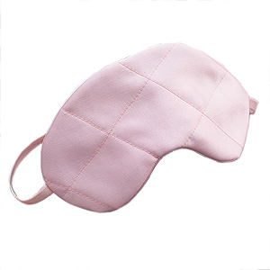 A satin eye mask from themonogramstudio.com.