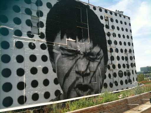 Mural along the High Line by JR