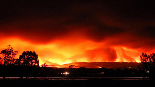 Fire storms over a hill at Maffra in Gippsland, Australia, Januray 2013. Photo: Simon Noble / Instagram