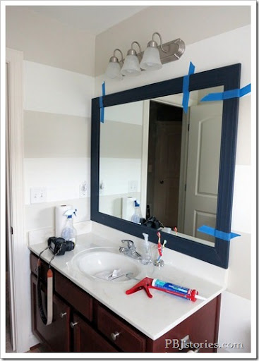 frame adhesive on mirror