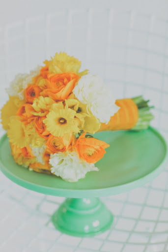 A bouquet of daffodils and ranunculus.