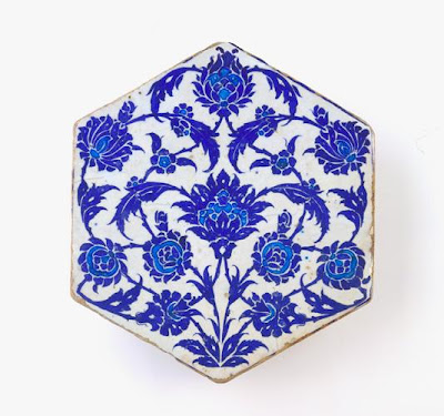 Tile | Origin:  Iznik,  Turkey | Period: ca. 1525-50  Ottoman period | Details:  During the early sixteenth century, Iznik ceramic production focused primarily on vessels. With the accession of the Ottoman ruler Sultan Sulayman (reigned 1522–60), and his ambitious building projects throughout the empire, demand for Iznik tiles grew and rivaled that for ceramic objects. The elegant design of this blue-and-white tile, combining full lotus flowers, broken stems, and serrated leaves, finds many parallels in contemporary ink drawings, textiles, and manuscript illumination. By drawing on a distinct body of designs and skillfully adapting these to different media, sixteenth-century Ottoman artists lend their work a recognizable visual unity and artistic identity. | Type: Stone-paste painted under glaze | Size:   H: 27.8  W: 24.4   D: 2.8  cm | Museum Code: F1998.298 | Photograph and description taken from Freer and the Sackler (Smithsonian) Museums.