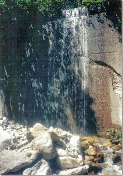 Water cascading over Concrete Snowshed Wall near Milepost 1712 on the Iron Goat Trail in 2000