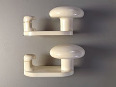 white mid century plastic wall coat hangers side