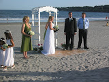 Lew and Cheryl, getting married on a piece of plywood in the sand