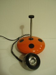 "Orange telescoping and magnetic ""eye"" table lamp"