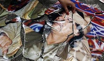 Gadafi en trozos