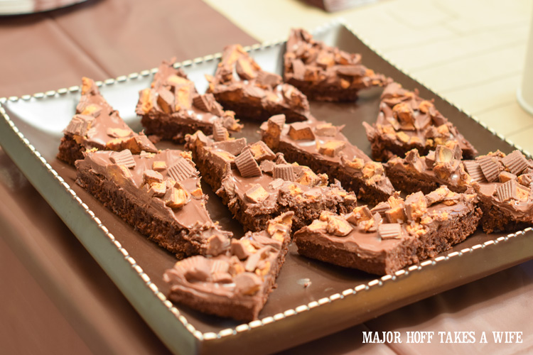 Peanut butter cup brownies satisfy the sweet tooth. An easy to throw party for the Big Game. Features easy party ideas for snacks, dips and decor. Includes a recipe for Roasted Red Pepper Hummus without seeds! #BigGameSnacks #collectiveBias #ad