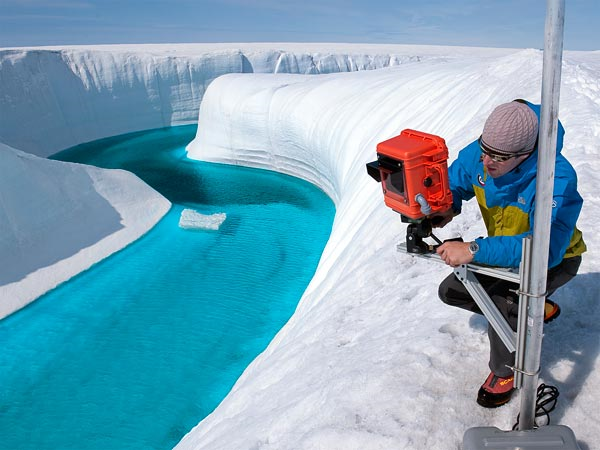 Adam LeWinter installs a camera on the Greenland ice sheet in 2009. The polar ice sheets are indeed shrinking—and fast, according to a comprehensive 2012 study on climate change.  James Balog / National Geographic