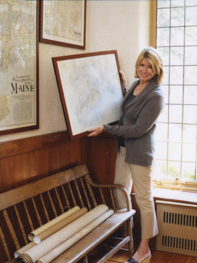 Martha hanging maps in a passageway at Skylands (Martha Stewart Living, June 2007)