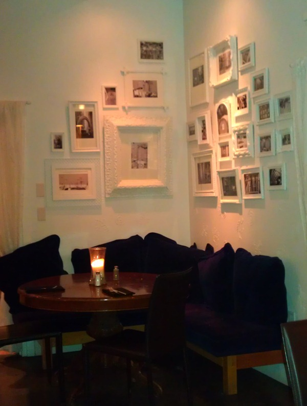 White gallery wall (Mica Restaurant via Little Victorian)
