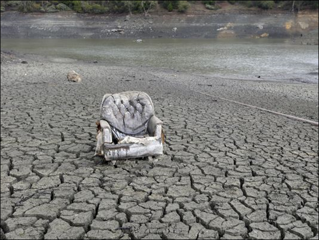 The bed of the Almaden Reservoir in San Jose was cracked-dry in early February. By the end of April 2014, 100 percent of the state of California was in a drought. Photo: Marcio Jose Sanchez / AP
