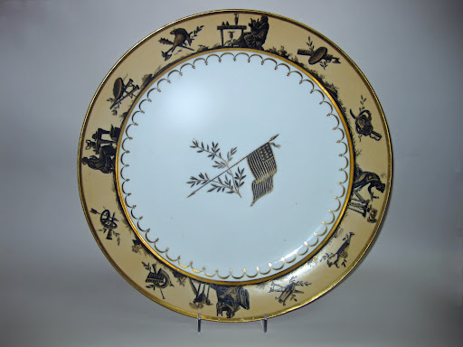 Extremely rare Napoleonic Porcelain dinner service made for the American market, featuring an American Colonial flag with thirteen stars and stripes and berried laurel branches.  The service originally consisted of more than 131 pieces.