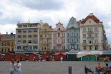 Historical houses (and a street festival) along Plzen's Square of the Republic. The Square's history goes back to the 13th century.