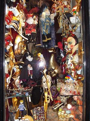 A window shot of the traditional Venetian masks. They make a fun, whimsical decorating item. 