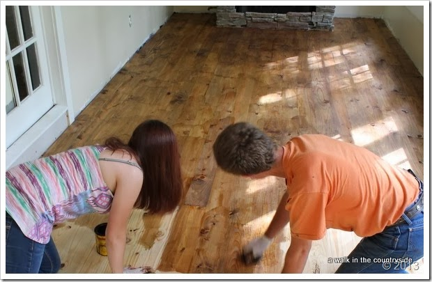 staining wood floor in sunroom