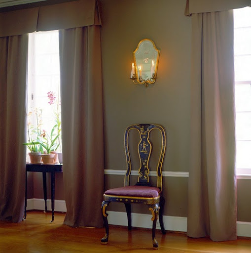 I love the combination of the plum-colored upholstery with this wall color. (Martha Stewart Living)
