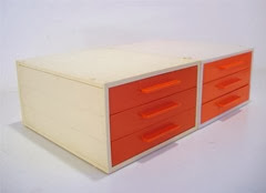 orange face drawers side by side