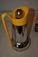 yellow and chrome coffee carafe