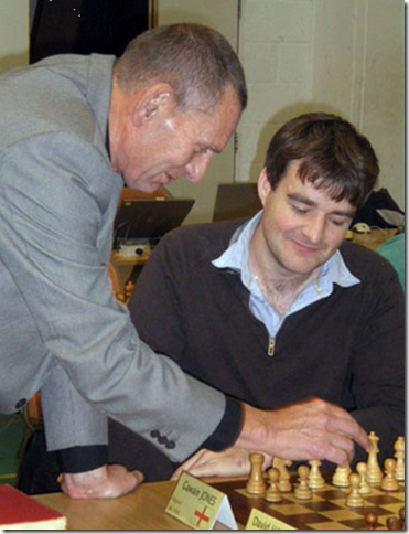 GM Gawain Jones watches as Councillor Jeremy Birch makes the customary first move