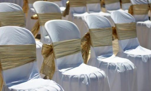 A few years ago chairs at weddings were usually covered with fabric and a